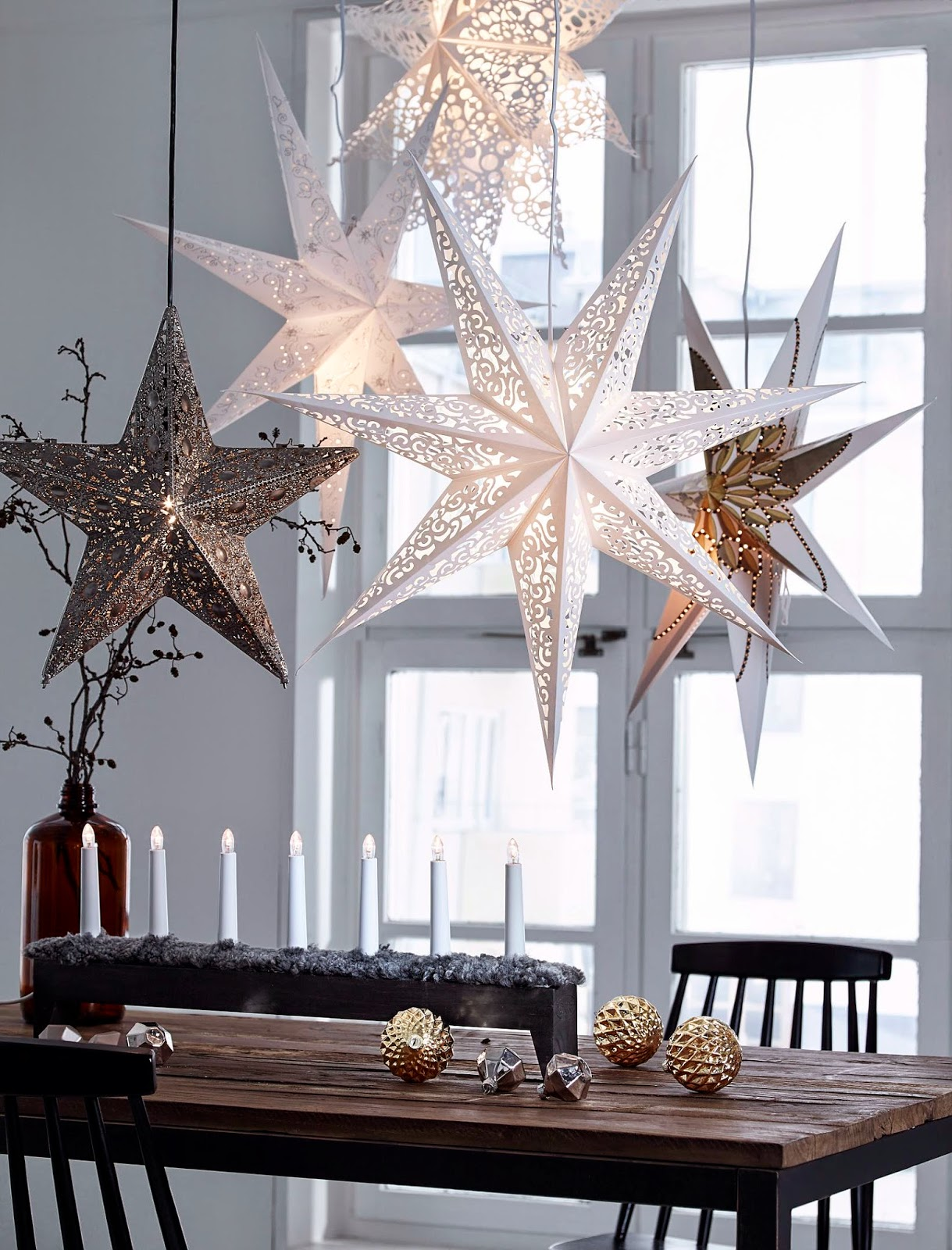 Scandi style Christmas dining table with metal star decorations