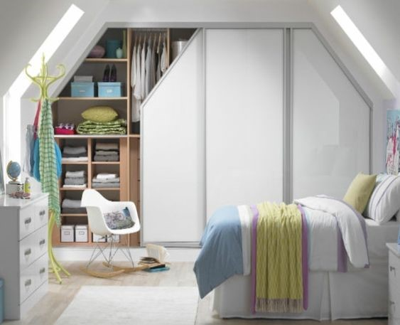 Classic fitted wardrobes for an attic bedroom